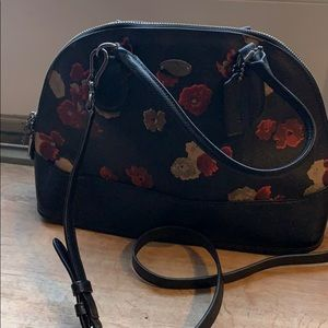Coach black leather purse with red/tan flowers